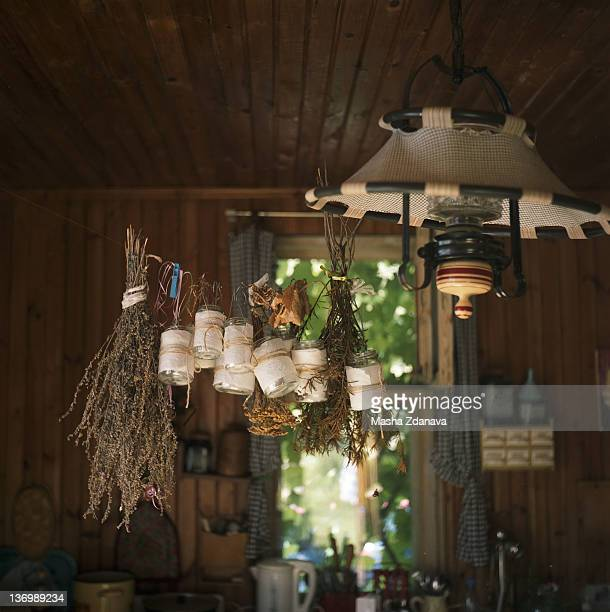Country house kitchen with dried herbs hanging
