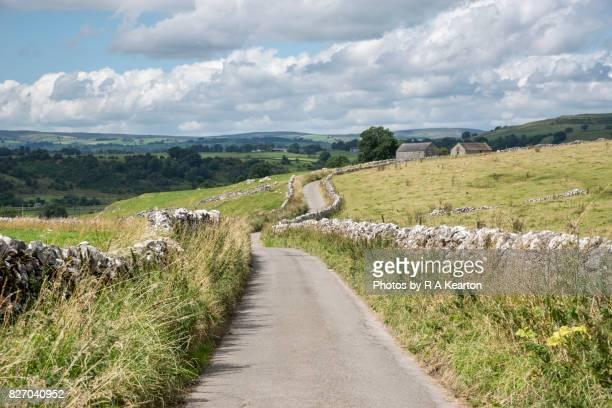 Country lane in the White Peak, Hartington, Derbyshire, England.