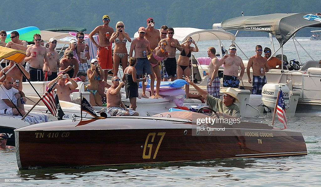 Country music artist Alan Jackson arrives on his 1923 Hacker Craft 'Hoochie Coochie' before performing for over 40,000 fan in 10,000 boats during AquaPalooza on Lake Martin on July 25, 2009 in Alexander City, Alabama.