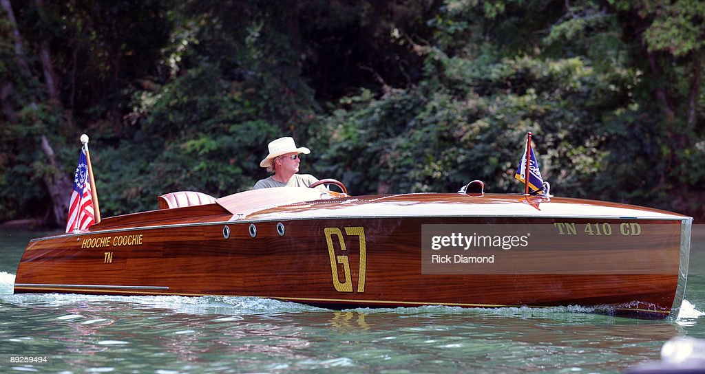 Country music artist Alan Jackson drives his 1923 Hacker Craft 'Hoochie Coochie' during an airing of 'Alan Jackson Aquaplooza on Lake Martin' filmed in front of over 40,000 fan in 10,000 boats during AquaPalooza on Lake Martin on July 25, 2009 in Alexander City, Alabama.