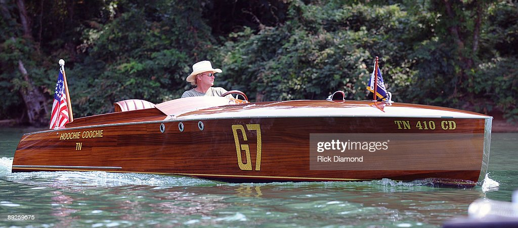 Country music artist Alan Jackson on his 1923 Hacker Craft 'Hoochie Coochie' tapes interview for CMT's Labor Day weekend airing of 'Alan Jackson Aquaplooza on Lake Martin' filmed in front of over 40,000 fan in 10,000 boats during AquaPalooza on Lake Martin on July 25, 2009 in Alexander City, Alabama.