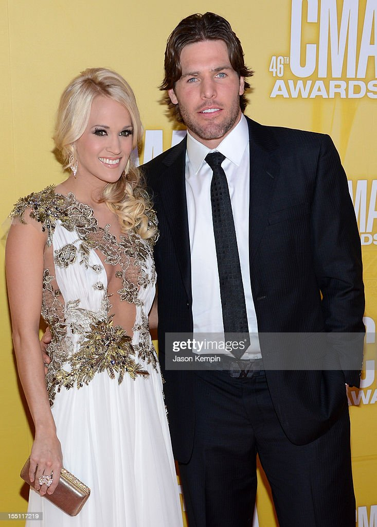 Country music artist Carrie Underwood and hockey player Mike Fisher attend the 46th annual CMA Awards at the Bridgestone Arena on November 1, 2012 in Nashville, Tennessee.