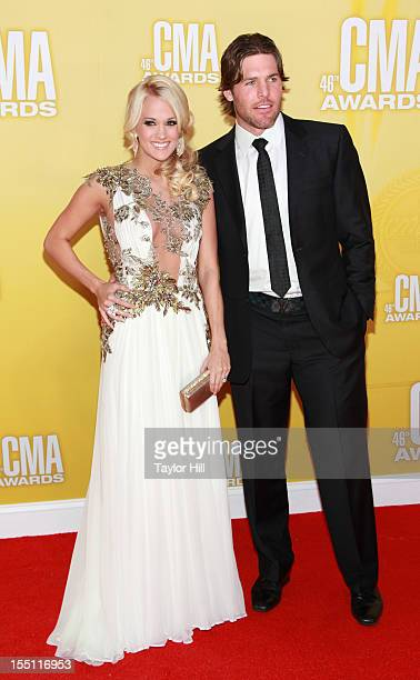Country music artist Carrie Underwood and Mike Fisher attend the 46th annual CMA Awards at the Bridgestone Arena on November 1 2012 in Nashville...