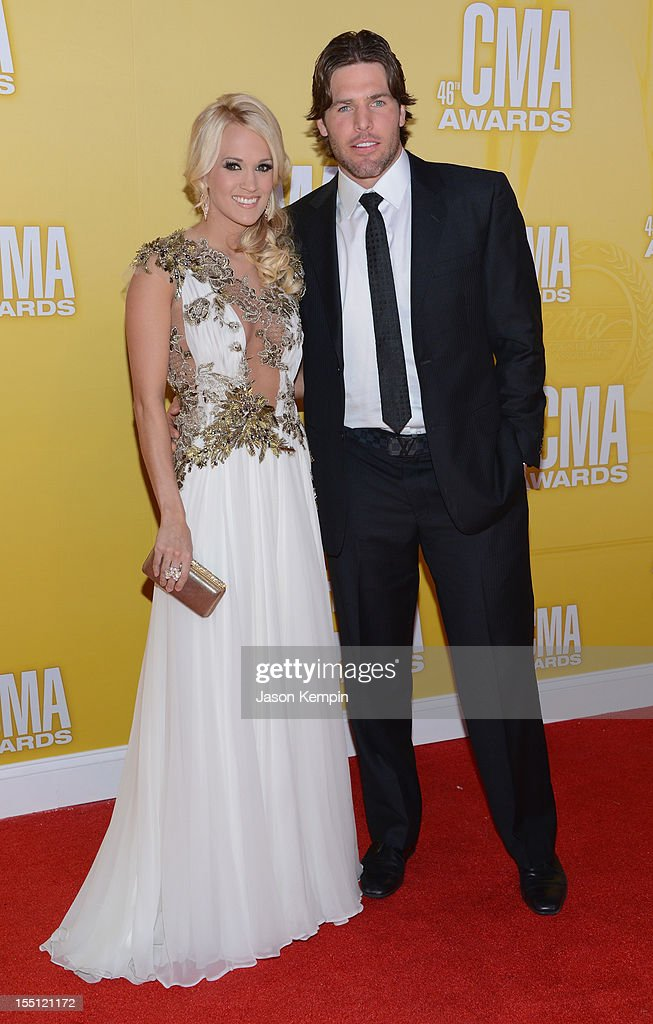 Country music artist Carrie Underwood and Mike Fisher attend the 46th annual CMA Awards at the Bridgestone Arena on November 1, 2012 in Nashville, Tennessee.