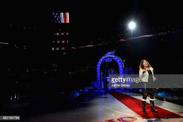 Country music artist Jo Dee Messina performs the national anthem before the 2015 Honda NHL AllStar Game between Team Toews and Team Foligno at...