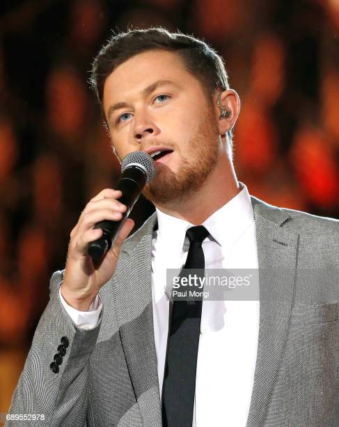 Country music artist Scotty McCreery performs at PBS' 2017 National Memorial Day Concert at US Capitol West Lawn on May 28 2017 in Washington DC