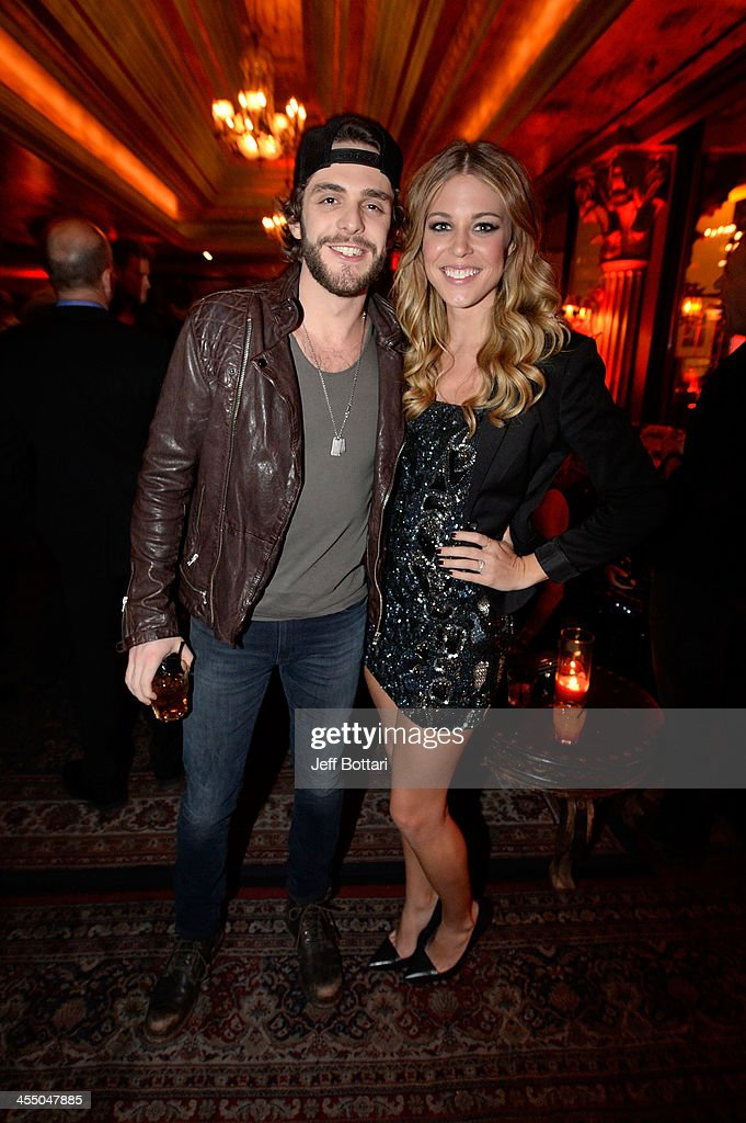 Country Music Artist <a gi-track='captionPersonalityLinkClicked' href=/galleries/search?phrase=Thomas+Rhett&family=editorial&specificpeople=9092574 ng-click='$event.stopPropagation()'>Thomas Rhett</a> (L) and his wife Lauren attend the Big Machine Label Group Crown Royal after party for the American Country Awards 2013 at the House of Blues Las Vegas Foundation Room inside the Mandalay Bay Resort and Casino on December 10, 2013 in Las Vegas, Nevada.