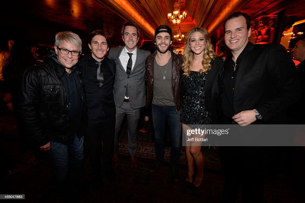 Country Music Artist <a gi-track='captionPersonalityLinkClicked' href=/galleries/search?phrase=Thomas+Rhett&family=editorial&specificpeople=9092574 ng-click='$event.stopPropagation()'>Thomas Rhett</a> (3rd from R) and his wife Lauren (2nd from R) pose with members of the Big Machine Label Group at the BMLG Crown Royal after party for the American Country Awards 2013 at the House of Blues Las Vegas Foundation Room inside the Mandalay Bay Resort and Casino on December 10, 2013 in Las Vegas, Nevada.