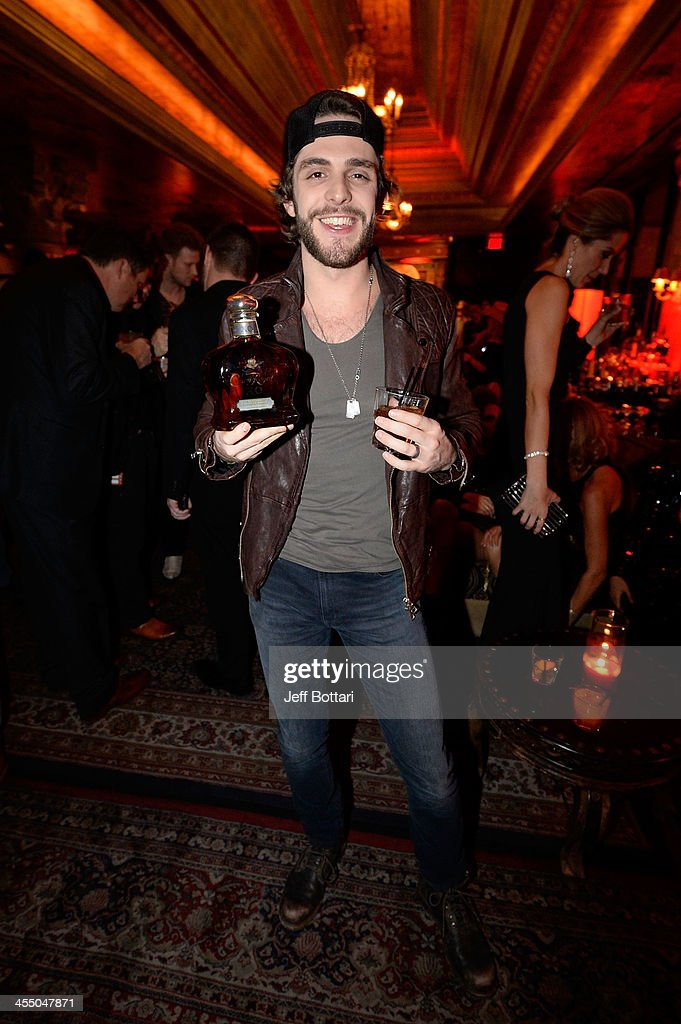 Country Music Artist <a gi-track='captionPersonalityLinkClicked' href=/galleries/search?phrase=Thomas+Rhett&family=editorial&specificpeople=9092574 ng-click='$event.stopPropagation()'>Thomas Rhett</a> celebrates an extraordinary night with a bottle of the new Crown Royal XO at the Big Machine Label Group Crown Royal after party for the American Country Awards 2013 at the House of Blues Las Vegas Foundation Room inside the Mandalay Bay Resort and Casino on December 10, 2013 in Las Vegas, Nevada.