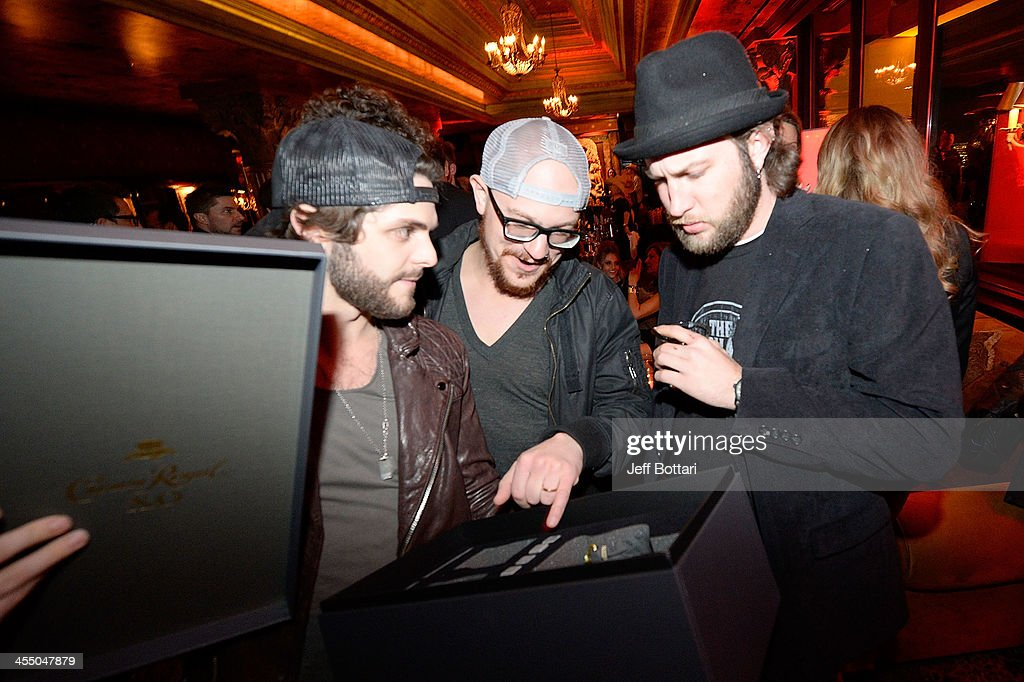 Country Music Artist <a gi-track='captionPersonalityLinkClicked' href=/galleries/search?phrase=Thomas+Rhett&family=editorial&specificpeople=9092574 ng-click='$event.stopPropagation()'>Thomas Rhett</a> (L) shows his friends a special bottle of the new Crown Royal XO at the Big Machine Label Group Crown Royal after party for the American Country Awards 2013 at the House of Blues Las Vegas Foundation Room inside the Mandalay Bay Resort and Casino on December 10, 2013 in Las Vegas, Nevada.