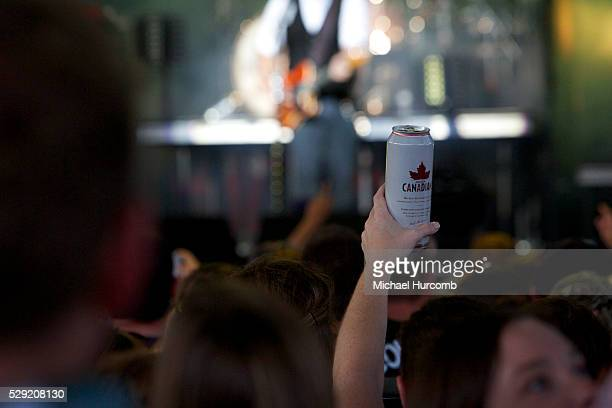 A country music fan holds up a can of beer at the Molson Canadian Amphitheatre in Toronto Ontario