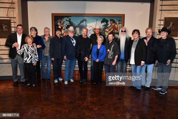 Country Music Hall of Fame Inductees Songwriter Don Schlitz and Recording Artist Alan Jackson pose along with existing Hall of Fame members during...