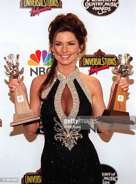 Country music performer Shania Twain holds the awards she received at the 31st Annual 'Academy of Counrty Music Awards' 24 April at Universal City...