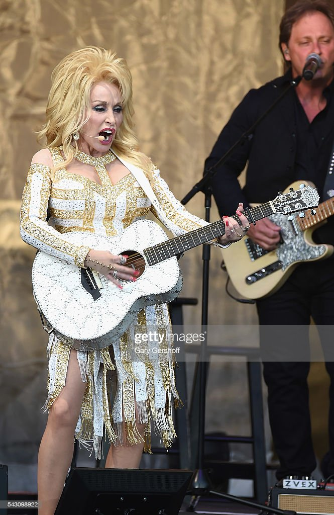 Country music recording artist <a gi-track='captionPersonalityLinkClicked' href=/galleries/search?phrase=Dolly+Parton&family=editorial&specificpeople=220238 ng-click='$event.stopPropagation()'>Dolly Parton</a> performs on stage during the 'Pure & Simple' tour at Forest Hills Stadium on June 25, 2016 in New York City.