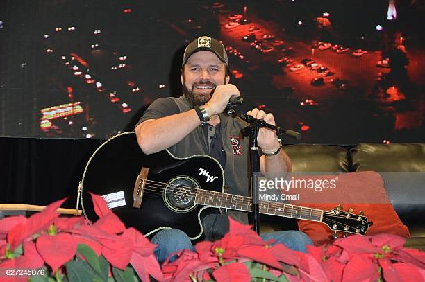 Country music recording artist Mark Wills performs during the 'Outside The Barrel' with Flint Rasmussen show at Rodeo Live during the National Finals...