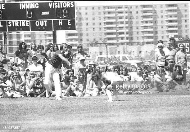 Country music singer Barbara Mandrell takes cover from Singer actor Pat Boone's ball throw at the Kenny Rogers Golden Nugget celebrity softball game...