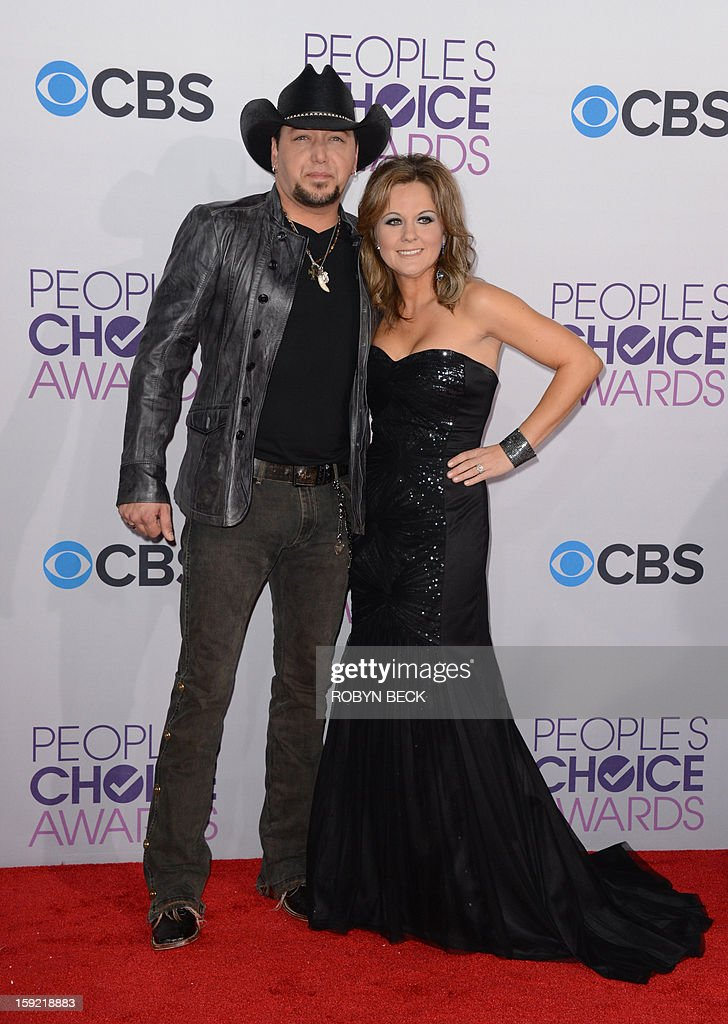 Country music singer Jason Aldean and wife Jessica Aldean arrive for the 2013 People's Choice Awards at the Nokia Theatre in Los Angeles, California, January 09, 2013. AFP PHOTO / Robyn Beck