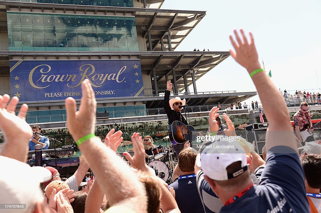 Country music singer <a gi-track='captionPersonalityLinkClicked' href=/galleries/search?phrase=Justin+Moore&family=editorial&specificpeople=2437772 ng-click='$event.stopPropagation()'>Justin Moore</a> performs at Indianapolis Motor Speedway on July 28, 2013 in Indianapolis, Indiana. As winner of the annual Crown Royal 'Your Hero's Name Here' program, Deeds received naming rights to the July 28th NASCAR Sprint Cup Series race at the Brickyard.