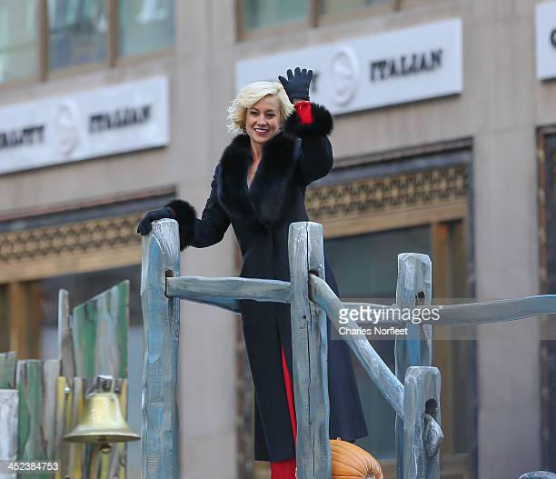 Country music singer Kelli Pickler waves to the crowd from the Discover and NHL's Frozen Fall Fun float during the 87th Annual Macy's Thanksgiving...