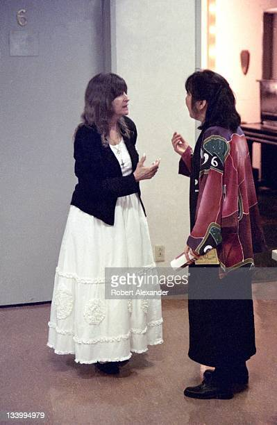 Country music singer Skeeter Davis talks with a fan from Japan backstage at the Grand Ole Opry circa 1995 in Nashville Tennessee