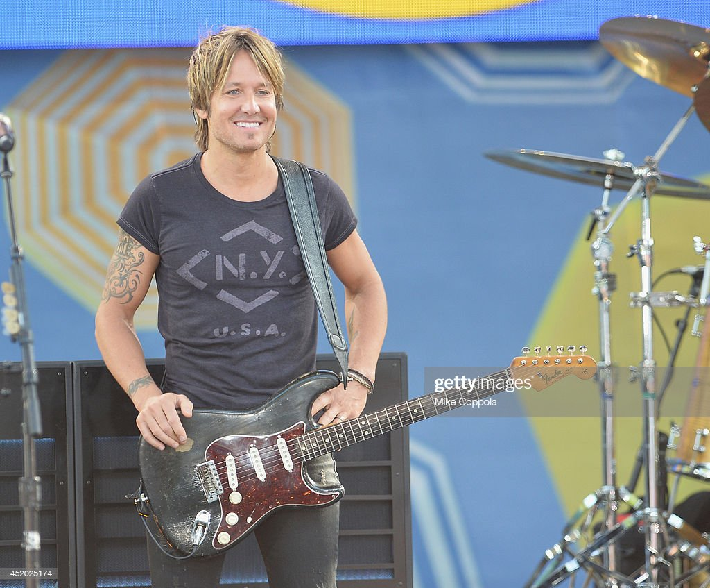 Country music singer/songwriter <a gi-track='captionPersonalityLinkClicked' href=/galleries/search?phrase=Keith+Urban&family=editorial&specificpeople=202997 ng-click='$event.stopPropagation()'>Keith Urban</a> Performs On ABC's 'Good Morning America' at Rumsey Playfield, Central Park on July 11, 2014 in New York City.