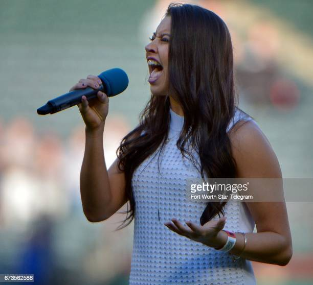 Country music star Sara Spicer sings the national anthem as the Texas Rangers play host to the Minnesota Twins at Globe Life Park in Arlington Texas...
