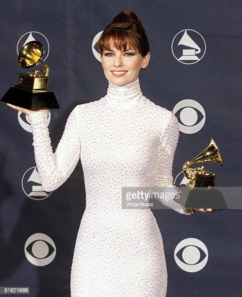 Country music star Shania Twain poses with her two Grammys for Best Country Song and Best Female Country Vocal Performance at the 41st Annual Grammy...