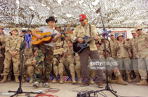 Country music star Toby Keith plays plays with Scotty Emerick during a United Service Organizations performance May 17 2005 at Camp Victory in...