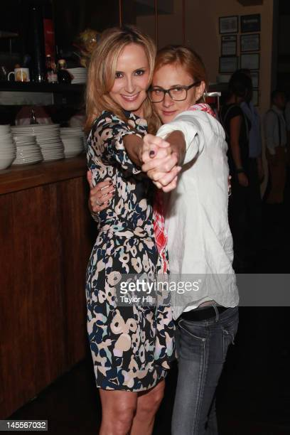 Country musician Chely Wright and wife Lauren Blitzer attend the 'Chely Wright Wish Me Away' New York After Party at Zio Restaurant on June 1 2012 in...