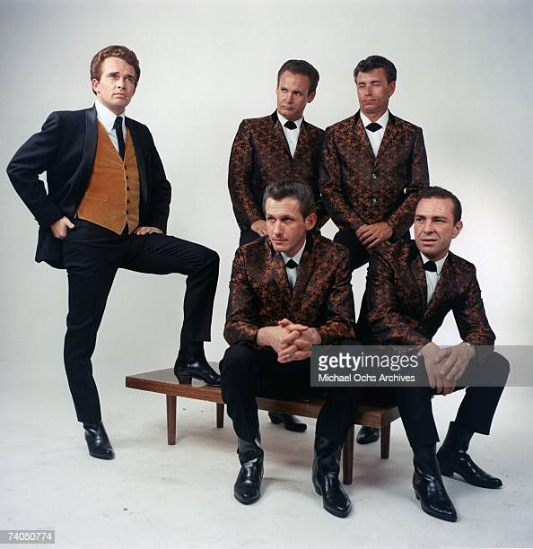 Country musician Merle Haggard and his band 'Merle Haggard the Strangers' pose for a September 1966 portrait in Los Angeles California Guitarist Roy...