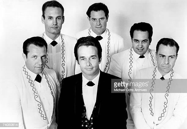 Country musician Merle Haggard poses with his band 'Merle Haggard the Strangers' featuring guitarist Roy Nichols for a 1967 portrait