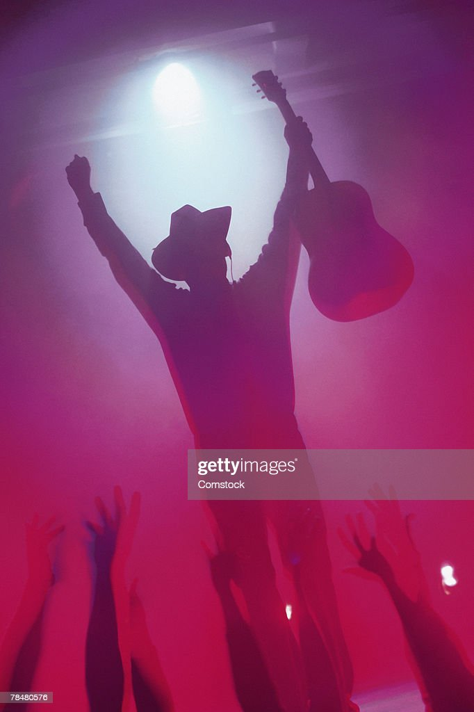 Country musician on stage at concert : Stock Photo
