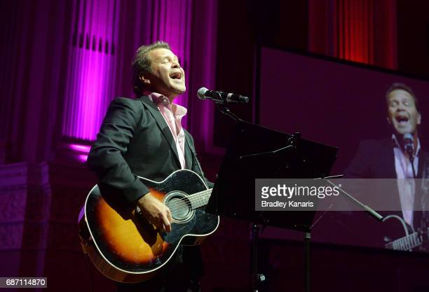 Country musician Troy CassarDaley performs during the Queensland Maroons State of Origin official launch at the Brisbane City Town Hall on May 23...