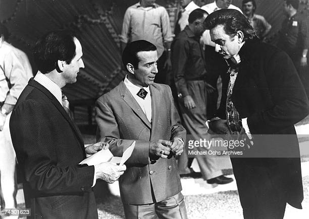 Country musicians Billy Deaton Faron Young and Johnny Cash chat in circa 1965