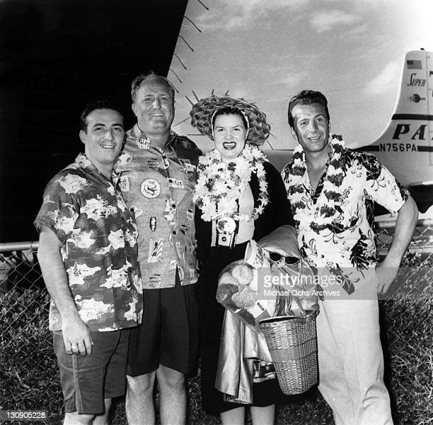 Country musicians Faron Young Patsy Cline and Ferlin Husky pose for a portrait wearing tropical clothing in circa 1960