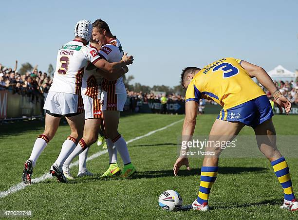Country players celebrate after James McManus of Country scores a try during the City v Country Origin match at McDonalds Park on May 3 2015 in Wagga...