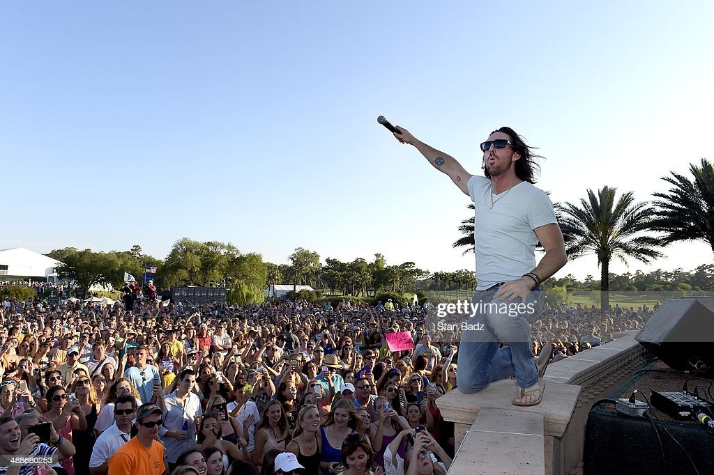 Country recording artist Jake Owen performs on stage during his concert during THE PLAYERS Championship on THE PLAYERS Stadium Course at TPC Sawgrass on May 7, 2014 in Ponte Vedra Beach, Florida.