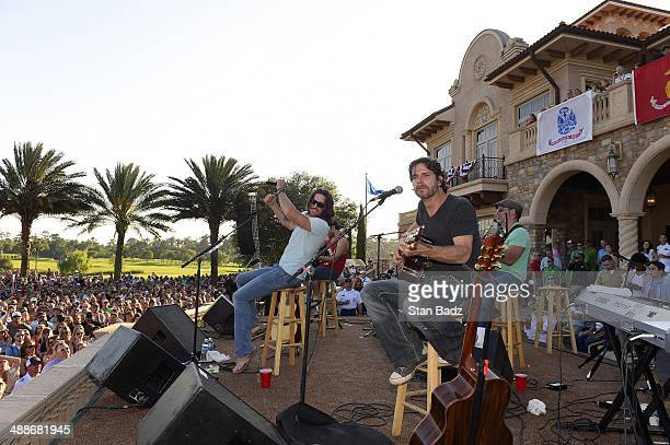 Country recording artist Jake Owen performs with his band on stage during his concert during THE PLAYERS Championship on THE PLAYERS Stadium Course...