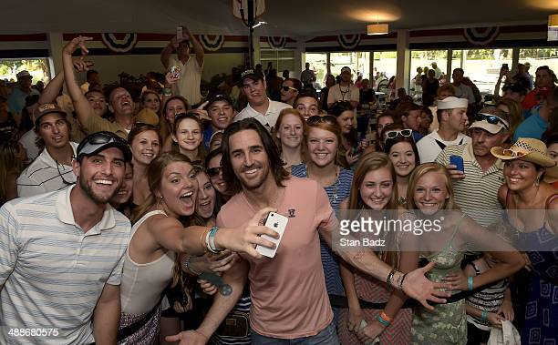 Country recording artist Jake Owen poses with his fans at the Military Outpost before his concert during THE PLAYERS Championship on THE PLAYERS...