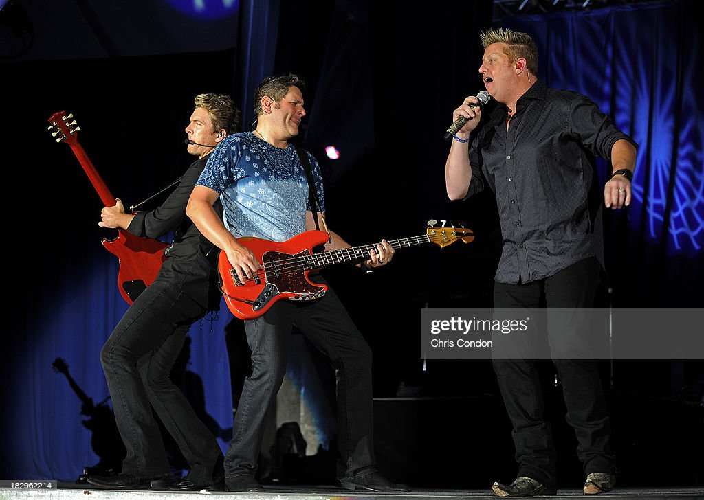 Country recording artists Rascal Flatts perform during the opening ceremonies at Columbus Commons prior to the start of The Presidents Cup at Muirfield Village Golf Club on October 2, 2013 in Dublin, Ohio.