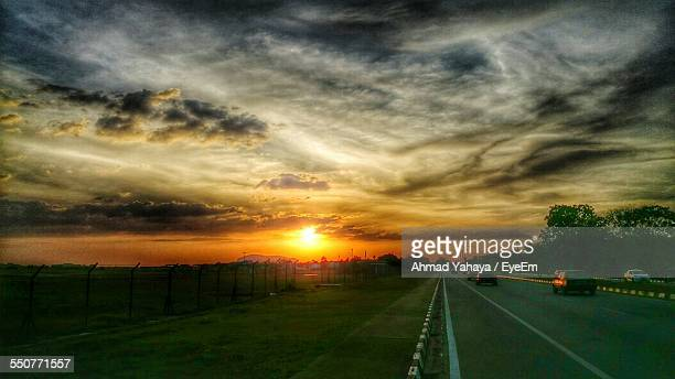Country Road Along Landscape At Sunset