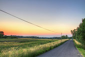 Country road and farms at evening