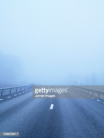 Country road covered with fog