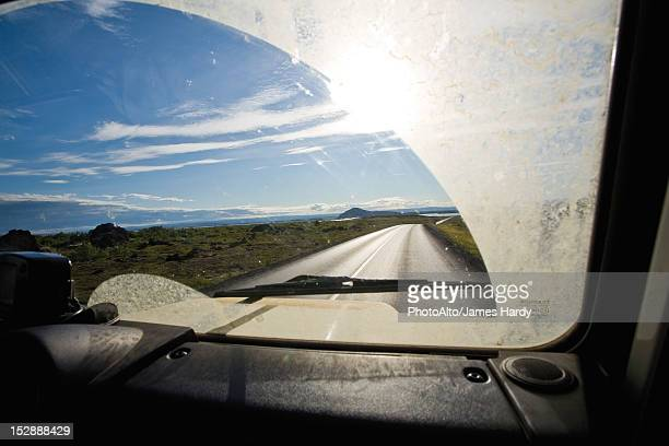 Country road viewed through car windshield