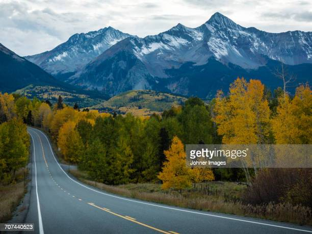 Country road with mountains on background