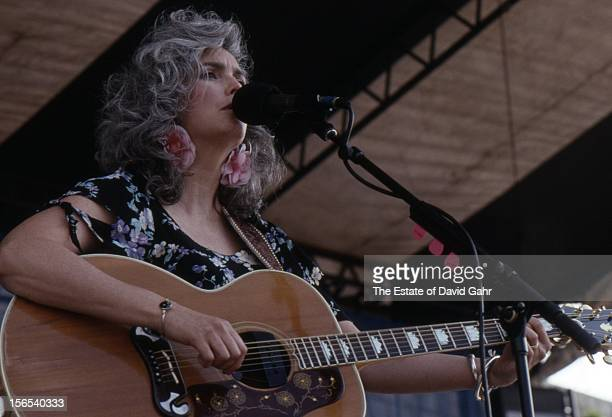 Country singer and musician Emmylou Harris performs in August 1989 at the Newport Folk Festival in Newport Rhode Island