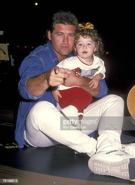 Country Singer Billy Ray Cyrus and Daughter Miley Cyrus attend the 'Elvis Presley Tribute Concert' on October 8 1994 at Pyramid Arena in Memphis...