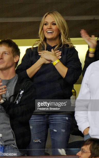 Country singer Carrie Underwood celebrates after a goal is scored by husband Mike Fisher of the Nashville Predators on February 17 2011 at the...