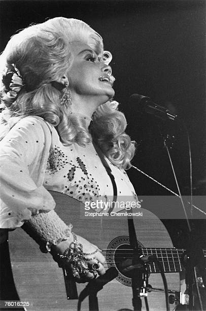 Country singer Dolly Parton performs onstage in January 1975