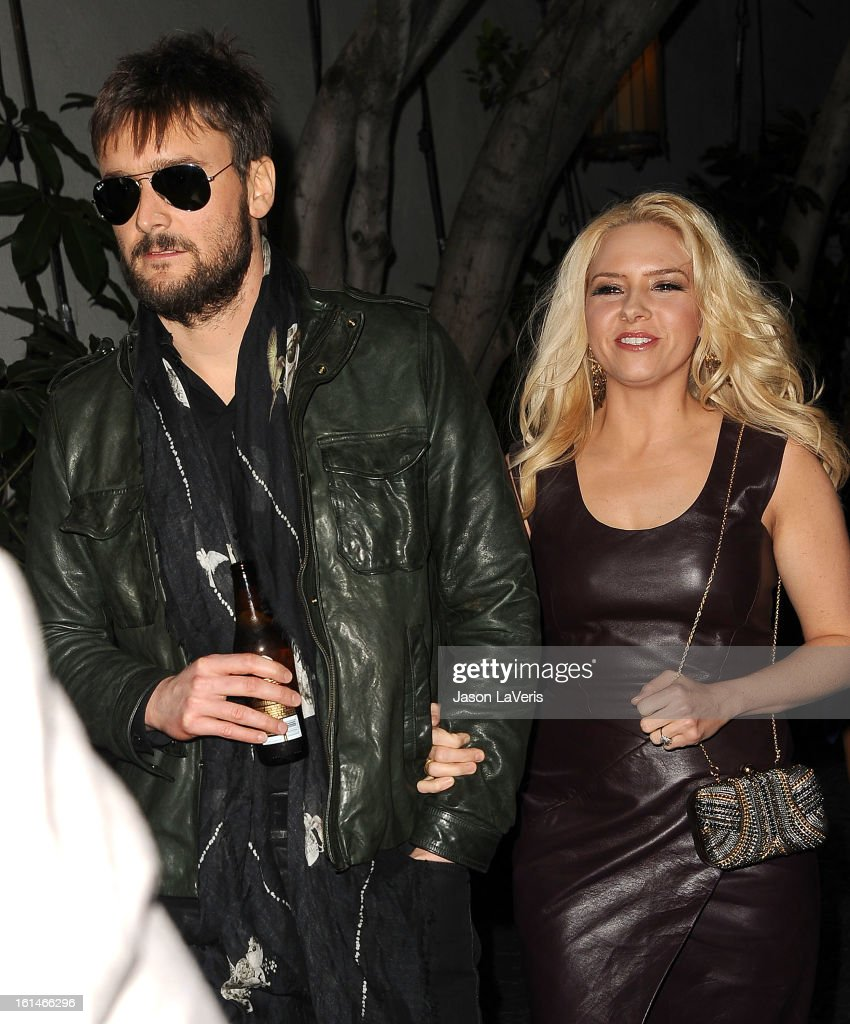 Country singer Eric Church and Katherine Blasingam attend the Warner Music Group 2013 Grammy celebration at Chateau Marmont on February 10 2013 in...